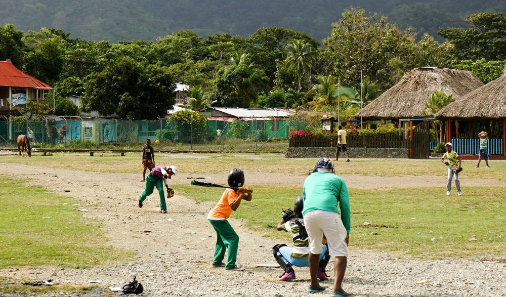 Kids playing baseball Capurgana field - chrisontour84