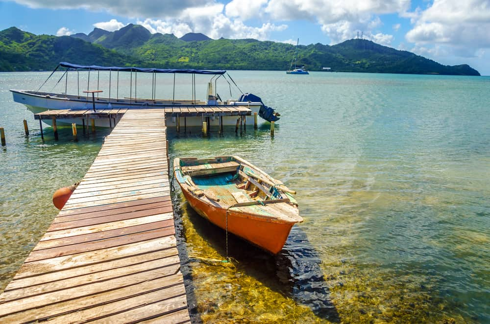 Orange boat and pier with view of San Andres y Providencia