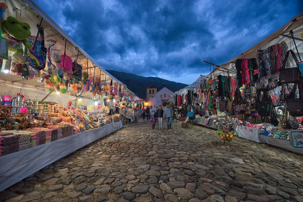 colourful vendor stand at night during the annual fiesta of the colonial town Villa - Barna Tanko